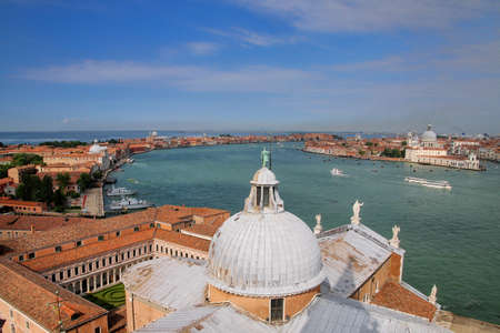 View of the dome of San Giorgio Maggiore church and Giudecca Canal in Venice, Italy. Venice is situated across a group of 117 small islands that are separated by canals and linked by bridges.