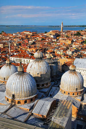 View of the domes of St Mark's Basilica in Venice, Italy. It is the most famous of the  churches in Venice and one of the best known examples of Italo-Byzantine architecture. Stock Photo