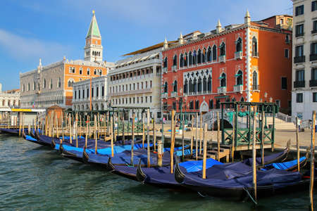 Gondolas moored near Piazza San Marco in Venice, Italy. Venice is situated across a group of 117 small islands that are separated by canals and linked by bridges.