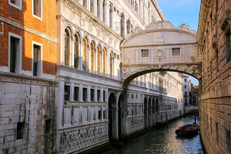 Ponte dei Sospiri (Bridge of Sighs) in Venice, Italy. Venice is situated across a group of 117 small islands that are separated by canals and linked by bridges. Stock Photo