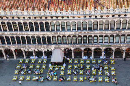 Outdoor cafe on Piazza San Marco in Venice, Italy. Venice is one of the most important tourist destinations in the world for its celebrated art and architecture