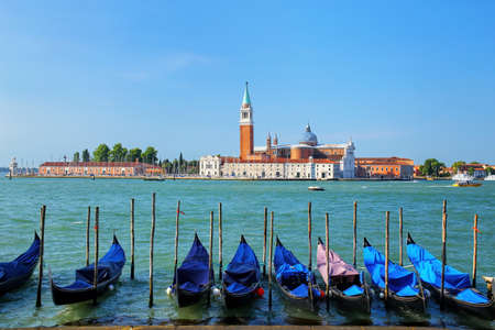 Gondolas moored near San Marco square across from San Giorgio Maggiore island in Venice, Italy. Gondolas were once the main form of transportation around the Venetian canals