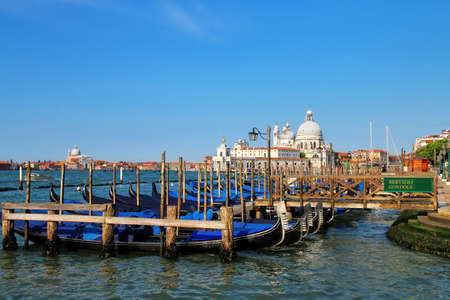 Gondolas moored near San Marco Square in Venice, Italy. Venice is situated across a group of 117 small islands that are separated by canals and linked by bridges.