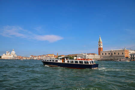 Vaporetto (water bus) going in front of Piazza San Marco in Venice, Italy. Venice is situated across a group of 117 small islands that are separated by canals and linked by bridges. Stock Photo