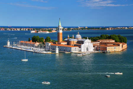 Aerial view of San Giorgio Maggiore Island in Venice, Italy. Venice is situated across a group of 117 small islands that are separated by canals and linked by bridges. Stock Photo