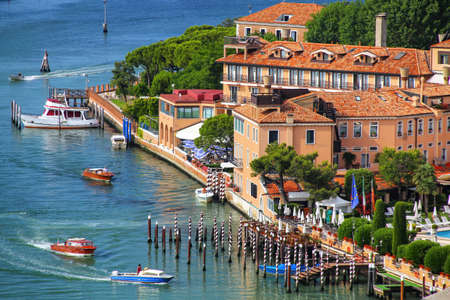 View of Giudecca Island in Venice, Italy. Venice is situated across a group of 117 small islands that are separated by canals and linked by bridges. Stock Photo