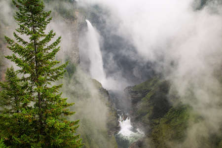 Helmcken Falls with fog, Wells Gray Provincial Park, British Columbia, Canada. It is fourth largest park in British Columbia.