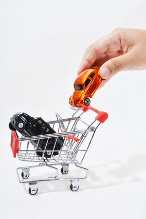 Hands gesture that put a car into a trolley. photo