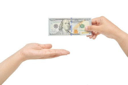 lend a hand: Hands gesture giving and receiving one hundred dollars. Stock Photo