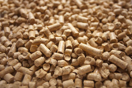 Wood pellets close-up texture background Stock Photo