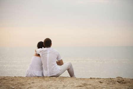 Couple on the beach at sunrise Stock Photo - 5350010