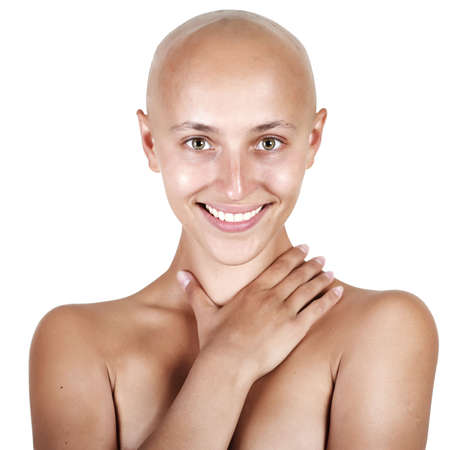skinhead: studio portrait of a young beautiful bald-headed girl