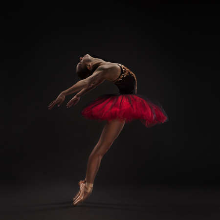 beautiful ballet dancer isolated on black photo