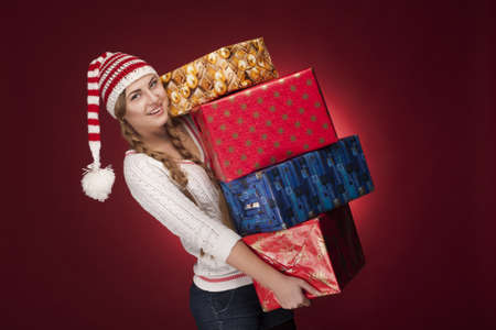 women with Santa hat with presents photo