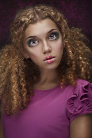 young beautiful doll girl with curly hair Stock Photo