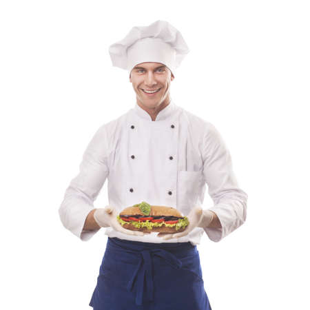 Chef holding a big sandwich photo