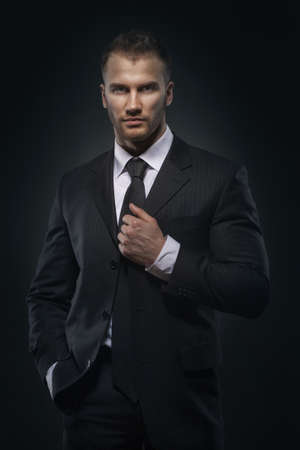businessman standing on dark background Stock Photo