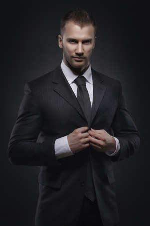businessman standing on dark background Stok Fotoğraf