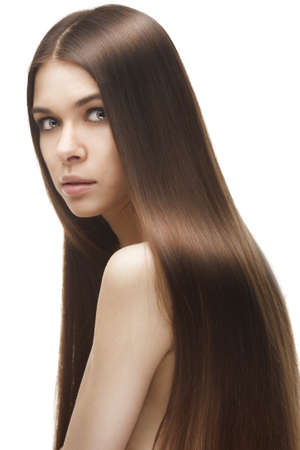 Beautiful woman with long straight hair photo