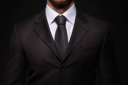 businessman standing on dark background Standard-Bild
