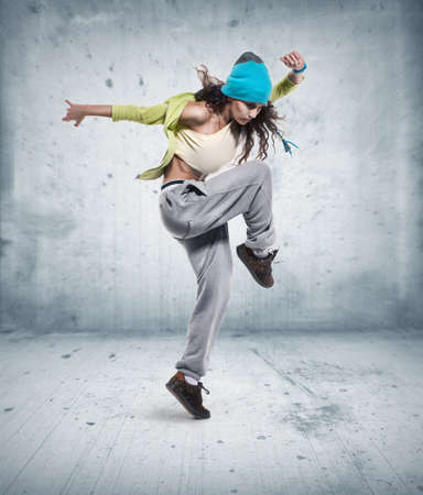 dancing pose: young woman hip hop dancer Stock Photo