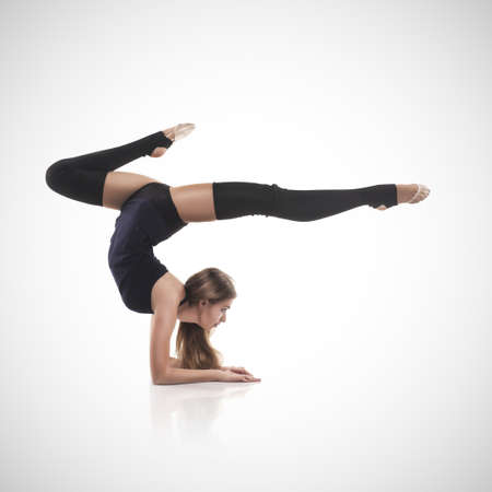 acrobat gymnast: woman in the gymnastic pose
