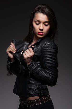 hot lips: Glamorous woman in black jacket Stock Photo