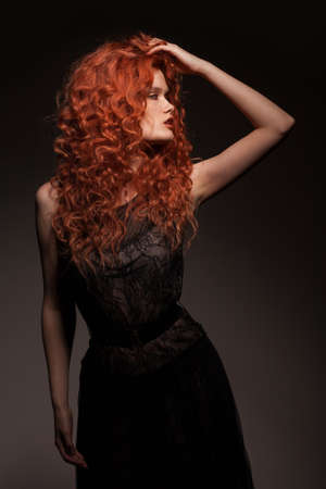 redhead woman with long hair photo