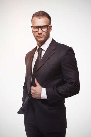 businessmanman in black suit and glasses
