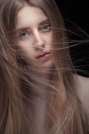 closeup portrait of young blond woman with long flying hair Stock Photo - 19339931