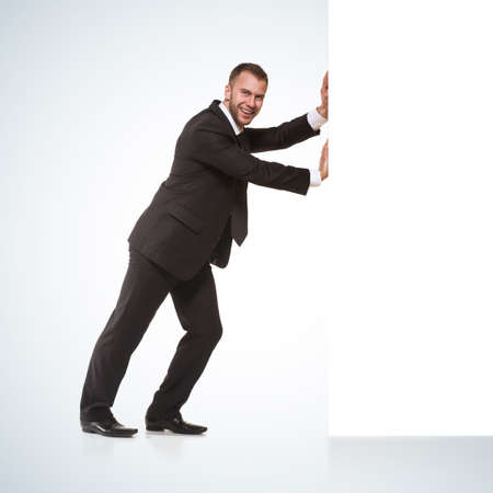 push people: Businessman pushing away something Stock Photo