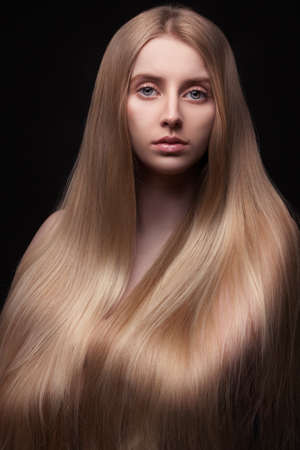 Photo of young beautiful woman with long hair photo