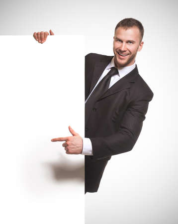 businessman holding blank billboard photo