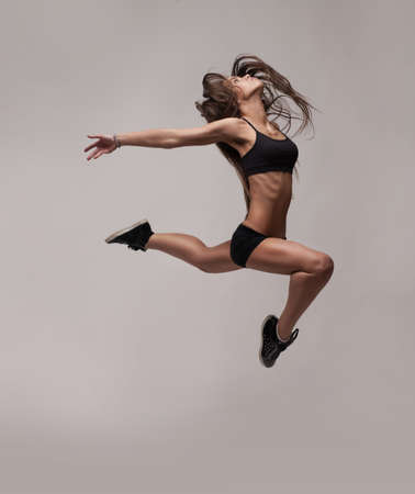 leap: caucasian fitness woman jumping Stock Photo