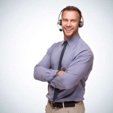 headset: smiling man wearing a headset on blue gradient background