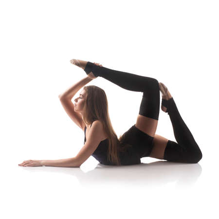 portrait of sport girl doing yoga stretching exercise, studio shot over white background photo
