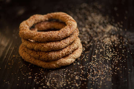 turkish bread: traditional Turkish bagels with sesame seeds on dark wooden background Stock Photo