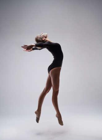 rhythmic: studio shoot of cute woman gymnast on grey studio background