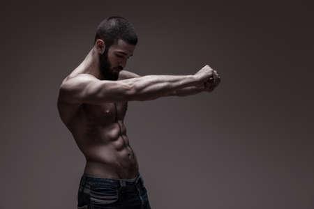 nipple man: strong athletic man on dark grey gradient background