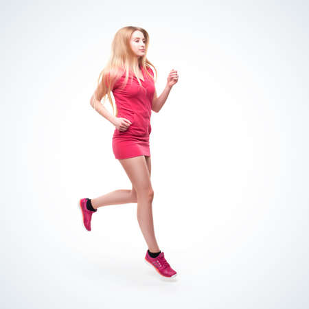 Runner blond woman isolated on gradient studio background photo