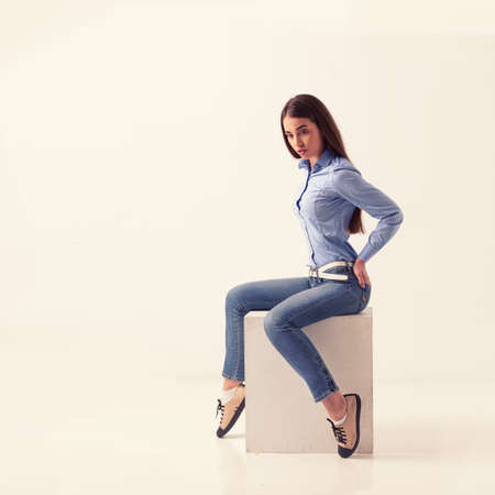 Full body of cheerful beautiful business woman, isolated over light studio background photo