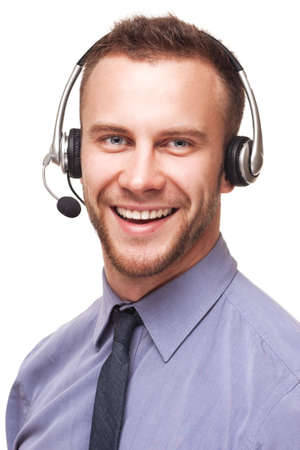 headset business: Handsome smiling young businessman using a headset isolated over white