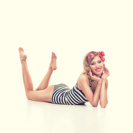 white girl: beautiful girl with pretty smile in pinup style on yellow background