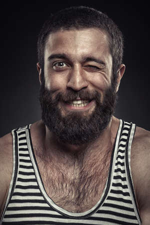Portrait of a bearded man on dark background 스톡 콘텐츠