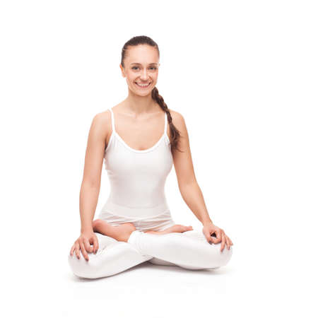 young beautiful woman yoga posing on isolated white studio background photo