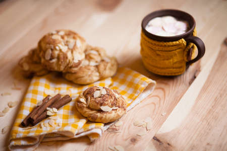 cappucino: almond cookies with cup of cappucino on light wood table