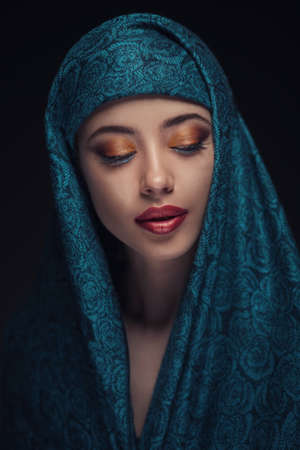 paranja: Portrait of a beautiful woman with arabian makeup in paranja isolated on dark background