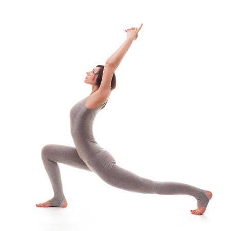 side pose: young beautiful woman yoga posing on isalated white studio background