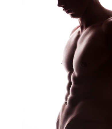 nipple man: closeup of strong athletic mans torso with copyspase on white background