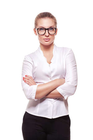 portrait studio: studio portrait of successful business woman in glasses with arms crossed.  isolated over white background Stock Photo